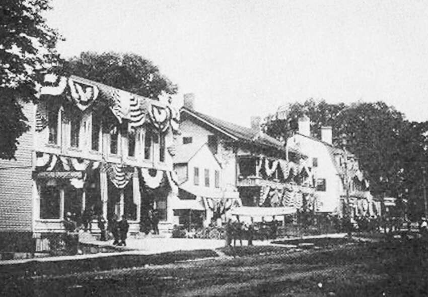 Flashback New Milford celebration Courtesy of the Bona family Back in the late 1800s and early 1900s, the growing town of New Milford focused its Fourth of July celebrations on its firemen's parade. Above, the village center is decked out in red,white and blue for the occasion, including the New England House Hotel, center, which was destroyed in the town's Great Fire of 1903. To the right is the United States Hotel, which lasted until the late 1920s. The two hotels for many years bookended the intersection of Main Street with Bank Street.Those who would like to loan or contribute a photo from any of the Greater New Milford-area towns should bring it to Norm Cummings at the Greater New Milford Spectrum office at 45B Main St. or email ncummings@newstimes.com. If the photo is to be returned, please leave a phone number and mailing address.