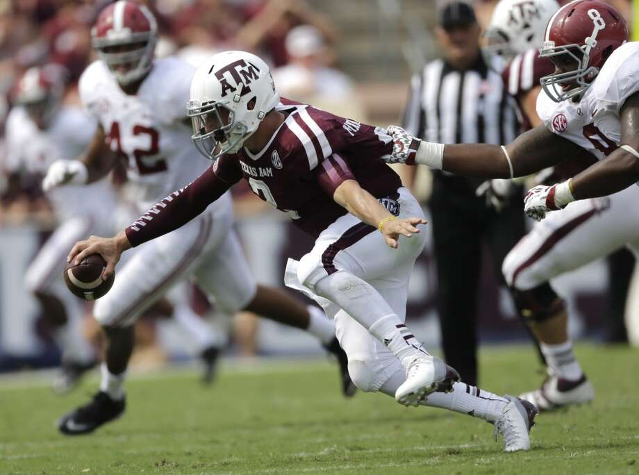 9,989 total offensive yards (best ever at A&M) Photo: David J. Phillip, Associated Press