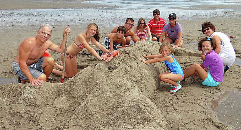 Several families collaborated on a lobster sand sculpture last year at the PAL sand sculpture contest. This year's contest will be held on July 20 at Penfield Beach. Photo: Staff Photo / Fairfield Citizen