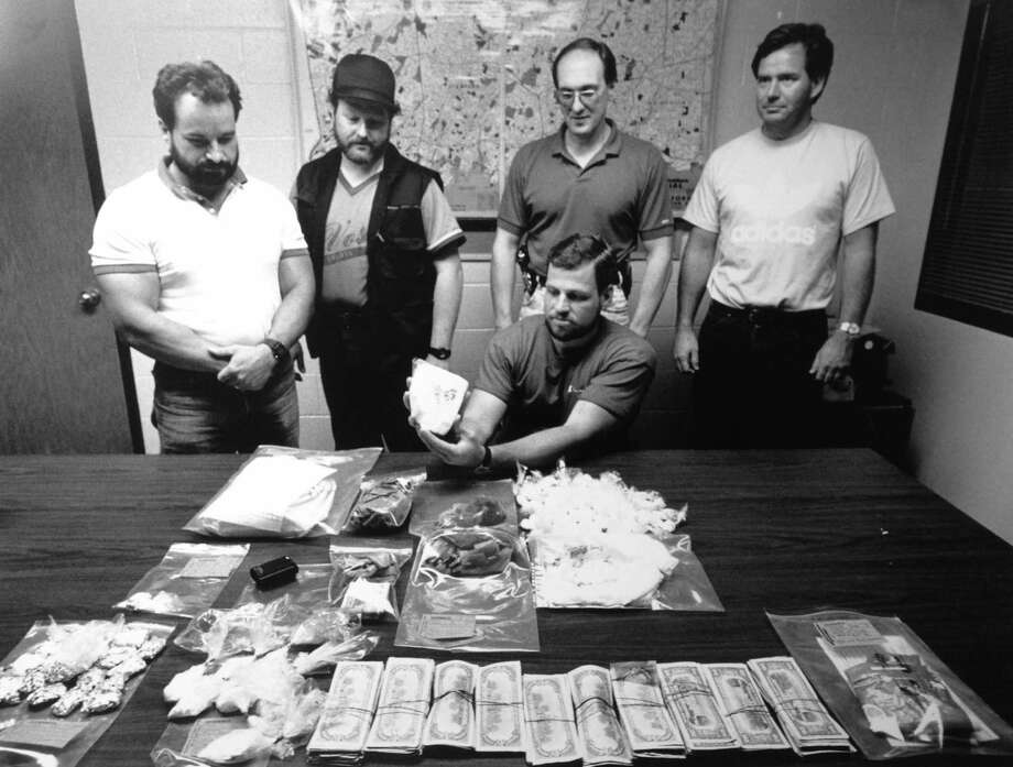 Stamford police show their cache from raids at two Stamford sites on July 18, 1989, where they seized more than a kilogram of cocaine worth an estimated $250,000. Photo: Contributed Photo / Stamford Advocate Contributed