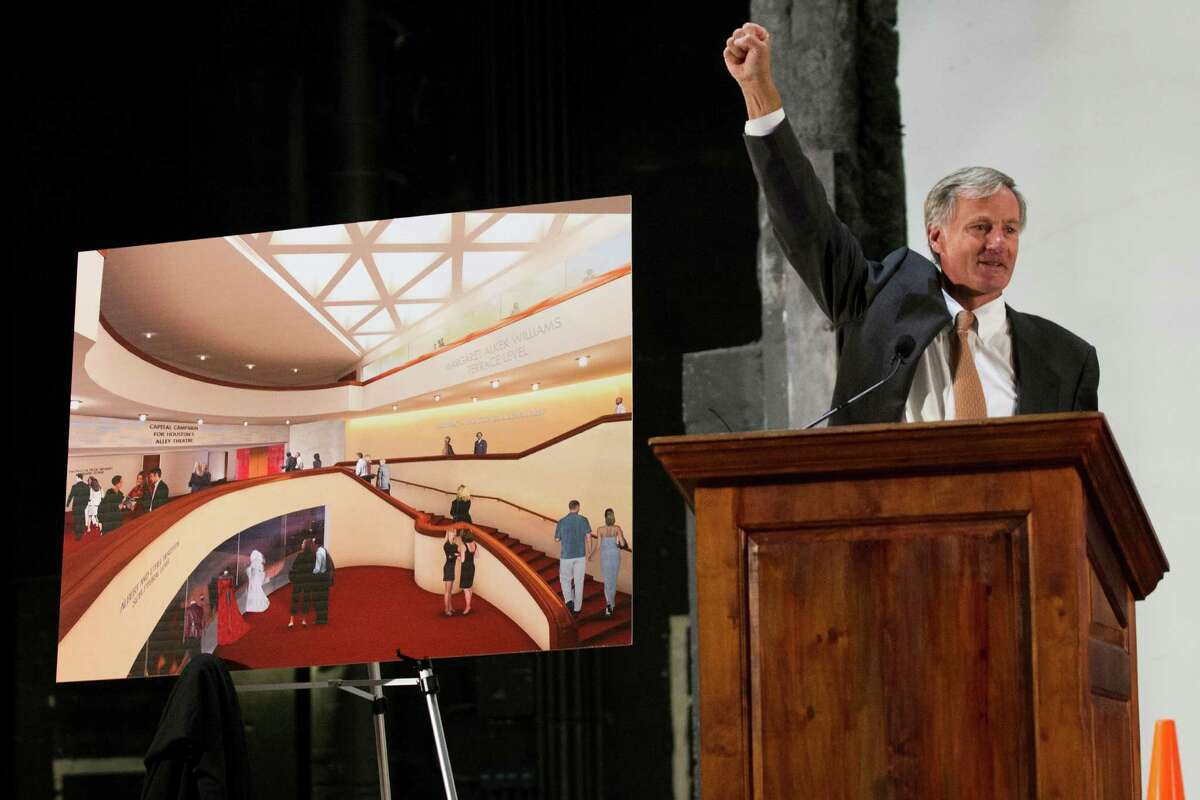 Roger Plank raises his fist in celebration after unveiling an artist's rendering of the Margaret Alkek Williams Terrace Level during a