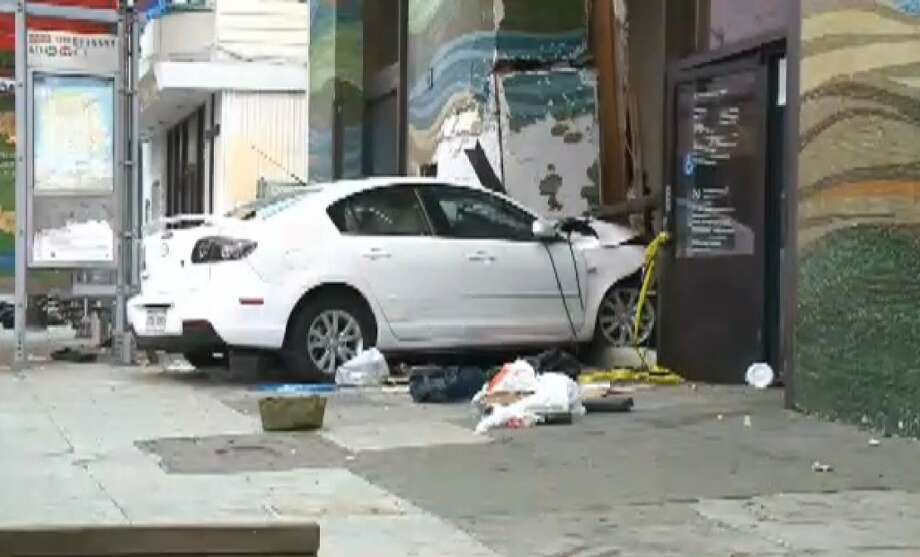 A car crashed into a bank on Mission Street in San Francisco's Excelsior District on Tuesday morning. Photo: CBS San Francisco