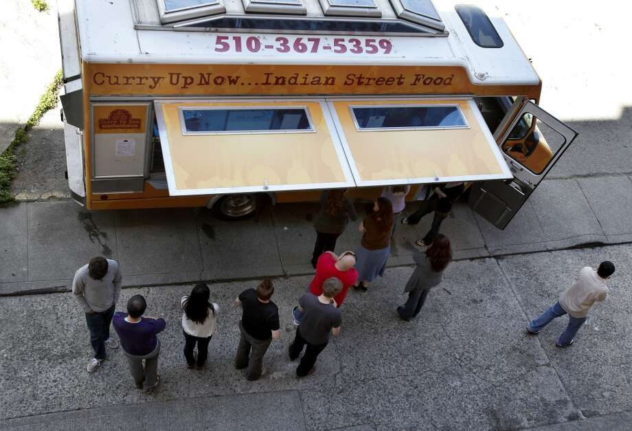 Curry Up Now is one of the several food trucks that will gather weekly in Uptown Oakland. Photo: Brant Ward, The Chronicle