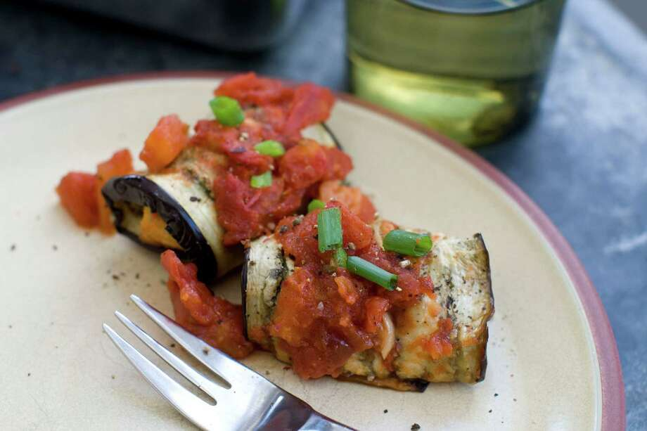 Inside-Out Eggplant Parmesan Rolls use croutons inside instead of traditional breading. Photo: Matthew Mead, FRE / FR170582 AP