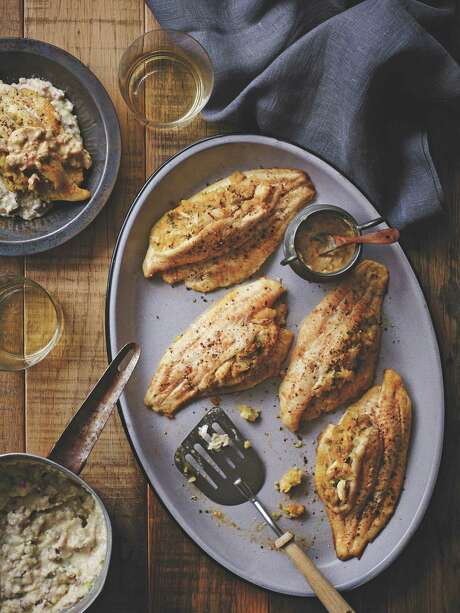 "Featured in ""Country Music's Greatest Eats,"" Louisiana Blue Crab-Stuffed Catfish Fillets are one of Zac Brown Band chef Rusty Hamlin's signature dishes. Photo: Courtesy Of Oxmoor House"