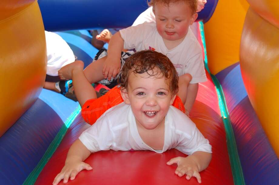 Rocco Meistrell and  Mason Price, both 18 months old, enjoy crawling through the Y's Fun Run Tunnels