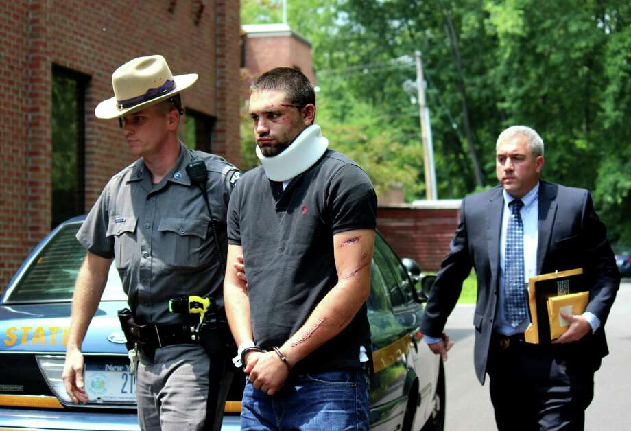 Tyler S. Pascuzzi, 24, of Coxsackie is escorted for his arraignment at Guilderland Town Court on Tuesday afternoon, July 8, 2014, in Guilderland, N.Y. He was charged with aggravated vehicular homicide, driving while intoxicated and other charges for Friday?s Thruway crash, which killed Alicia Tamboia, 24, of Dutchess County, and Cody Veverka, 23, of Cairo. Pascuzzi had been at Albany Medical Center Hospital since the crash, which occurred just before midnight Friday on between exits 24 and 25 on the Interstate 90. (Selby Smith / Special to the Times Union) Photo: Selby Smith / 00027708A