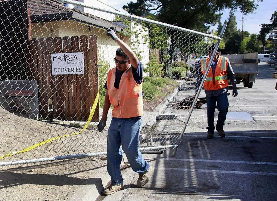A temporary fence is erected around the fire-damaged Manresa restaurant in Los Gatos, Calif., Monday, July 7. Photo: Karl Mondon, Associated Press