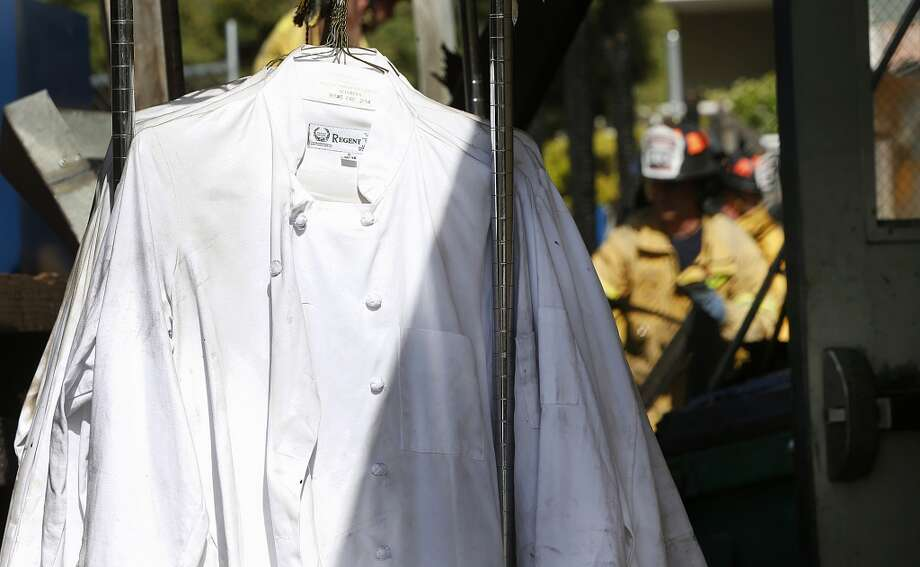 A rack of chef's jackets stands outside the fire-damaged Manresa restaurant in Los Gatos, Calif., Monday, July 7. Photo: Karl Mondon, Associated Press