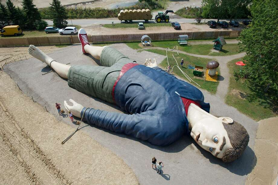 "Sponsored by Yahoo?A construction crew works on the ""Gulliver in Lilliput"" sculpture at the 