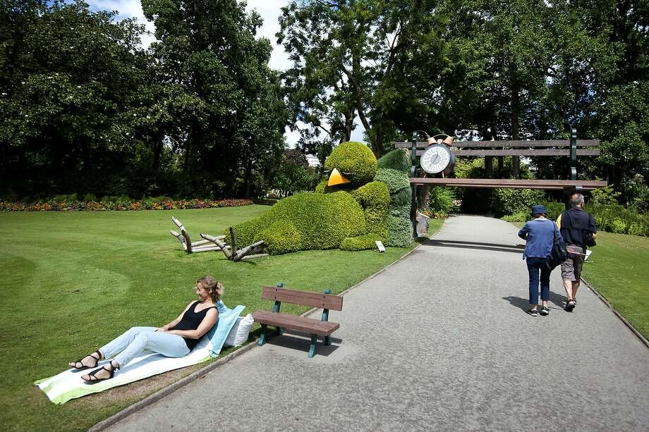 "Totally bushed: A avian topiary sculpture by French artist and children's book author Claude Ponti  rests in the botanical garden of Nantes, France. It's part of the ""Journey to Nantes"" art festival. Photo: Jean-Sebastien Evrard, AFP/Getty Images"