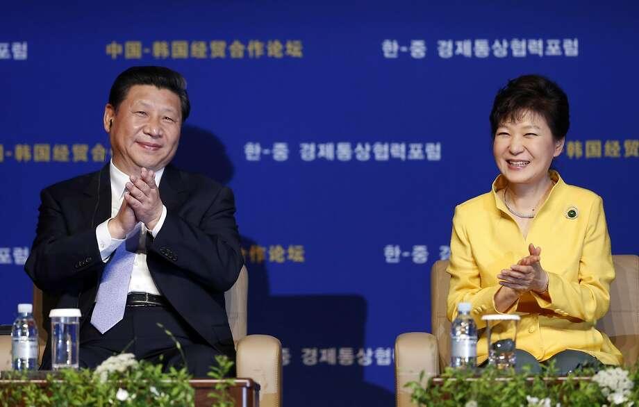 China President Xi Jinping (left) meets with South Korea President Park Geun-hye in Seoul. Photo: Kim Hong-ji, Associated Press