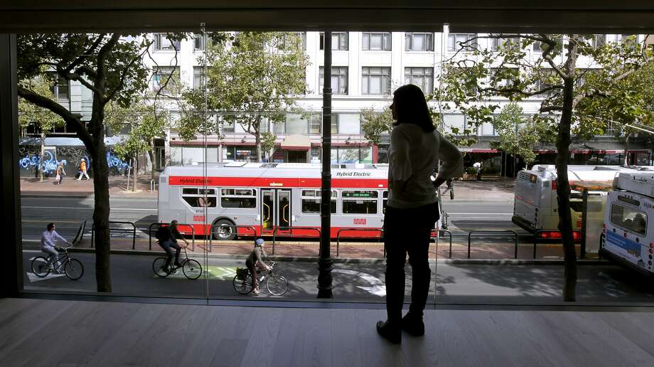 Tiffany Apezynski, director of social responsibility for Zendesk, looks out at Market Street from the second floor. Photo: Paul Chinn, The Chronicle
