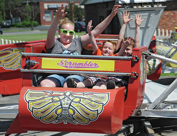 From left, Natalie McDonald of Kinderhook, 12, rides the scrambler with her younger brothers Colin, 4, and Aiden, 5, at Hoffman's Playland Thursday, June 19, 2014 in Latham, N.Y. (Lori Van Buren / Times Union) Photo: Lori Van Buren, Albany Times Union