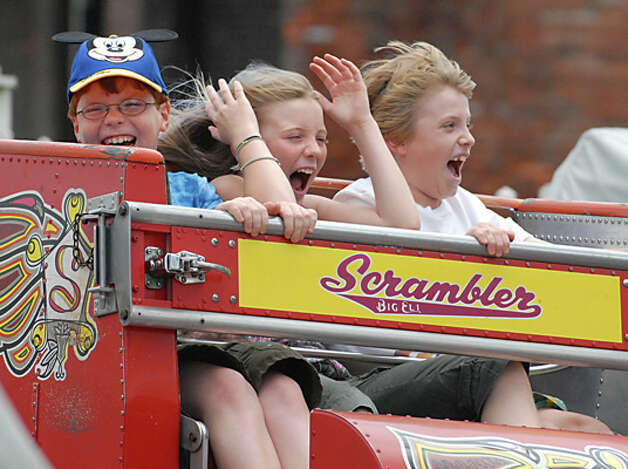 From left, Nicholas Millspaugh, age 10 of Hollis, New Hampshire, Isabella Sedita, age 9 of El Paso, Texas, and Peter Millspaugh, age 11, of Hollis, New Hampshire, ride the Scrambler ride at Hoffman's Playland in Latham, NY on July 3, 2009. The kids were visiting their grandparents in this area. For O'Brien story about how the rainy weather is affecting these kinds of places.  (Lori Van Buren / Times Union) Photo: LORI VAN BUREN/TIMES UNION, TIMES UNION / 00004612A