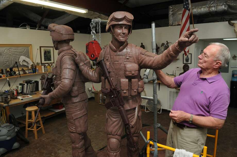 Edd Hayes of Atascocita works on his Way Home sculpture, a veteran memorial to be placed in Town Green Park in The Woodlands, at his Humble studio. Photo: Jerry Baker, Freelance