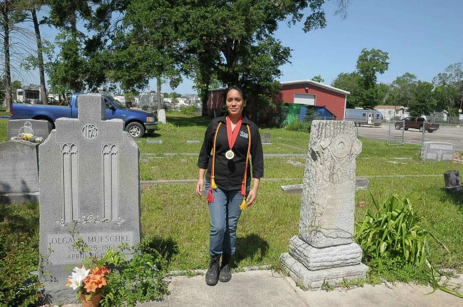 Janet Flores has received awards and honors for her Lone Star College honor project about Mueschke Cemetery just off of FM 1960 in Spring Saturday May 17, 2014. Photo: Â Tony Bullard 2014, Freelance Photographer / © Tony Bullard & the Houston Chronicle