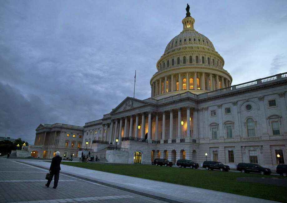 A reader says the reason nothing gets done in this country is the dysfunctional Congress, where officials are more interested in blaming each other than in solving problems. Photo: Evan Vucci / Associated Press / AP