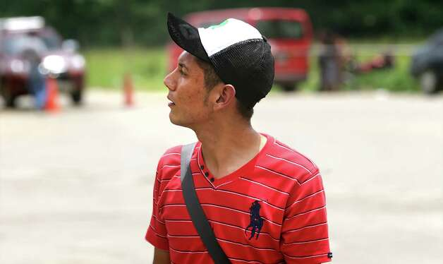 Luis Hernandez, 19, of Honduras, looks back at the Guatemalan border where he was turned away for being a minor, in Corinto, Honduras at the Guatemala border. Friday, June 27, 2014. Photo: Bob Owen, San Antonio Express-News / ©2013 San Antonio Express-News