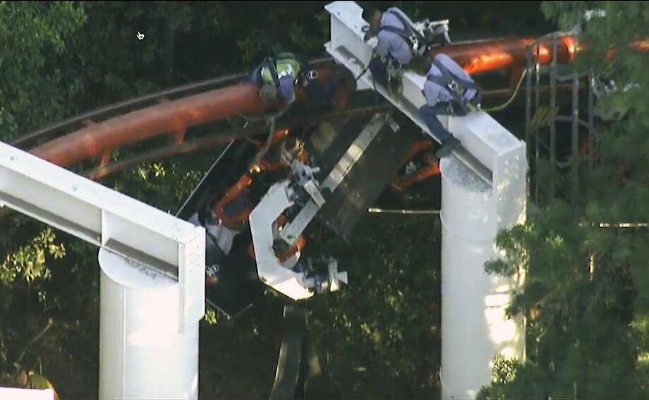 Six Flags Magic Mountain staff rescue Ninja roller-coaster riders after a tree derailed the front car. Photo: Uncredited, Associated Press