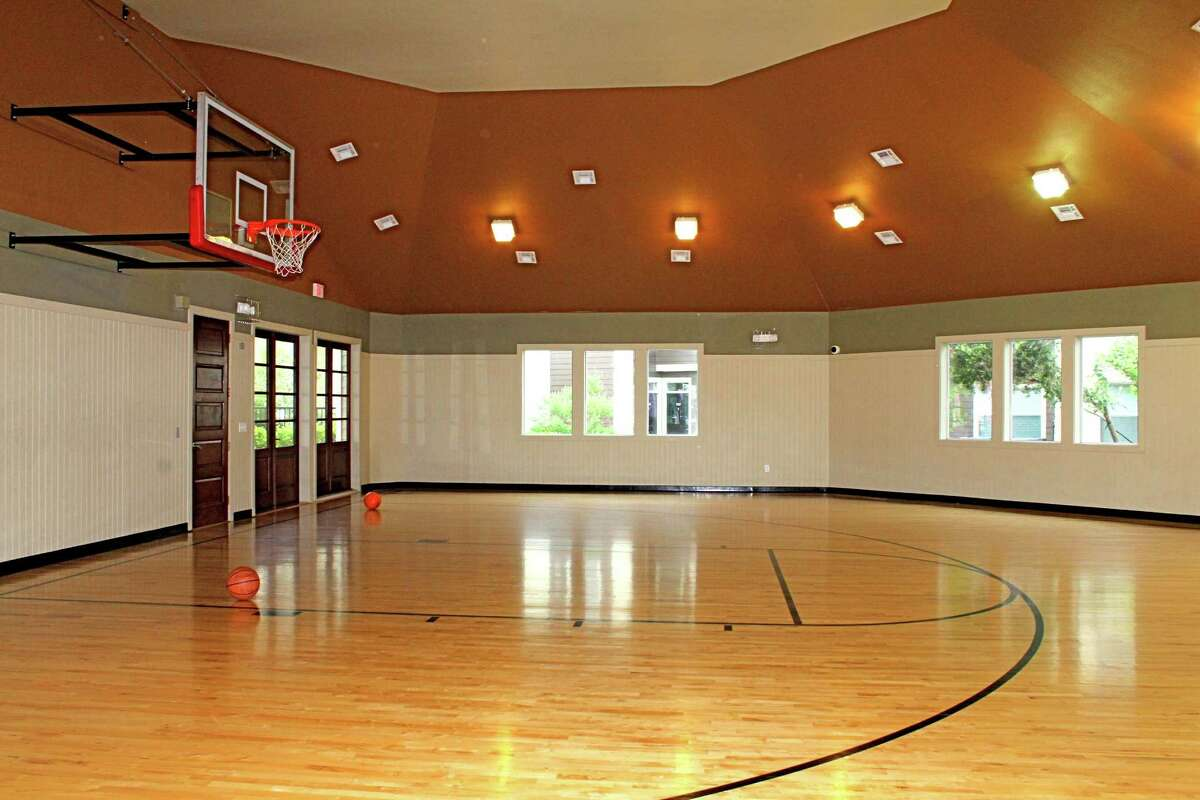 The indoor sports center includes a half basketball court at Oak Park Trails Apartments, 2005 S. Mason Road in Katy.
