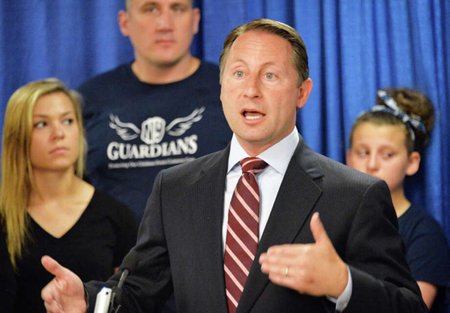 Republican gubernatorial candidate Rob Astorino, center, speaks at a news conference on Common Core at the LCA Pressroom in the Legislative Office Building Tuesday July 8, 2014, in Albany, NY.  (John Carl D'Annibale / Times Union) Photo: John Carl D'Annibale, Albany Times Union / 00027688A