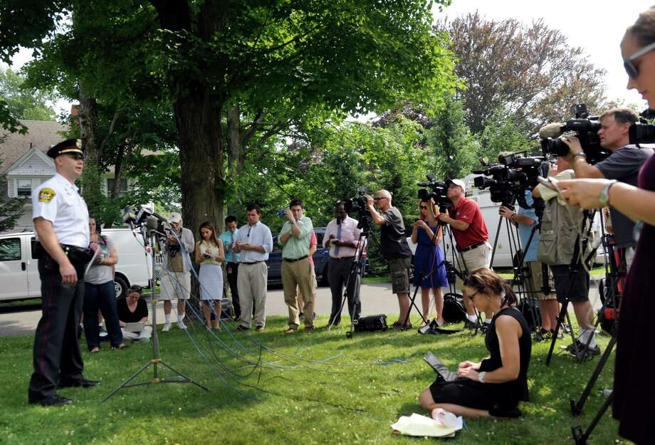 Captain Jeff Kreitz, public information officer with the Ridgefield Police Dept., addresses the media Tuesday afternoon during a press conference regarding the death of a child left in a hot car, Tuesday, July 8, 2014 in Ridgefield, Conn. Photo: Carol Kaliff / The News-Times