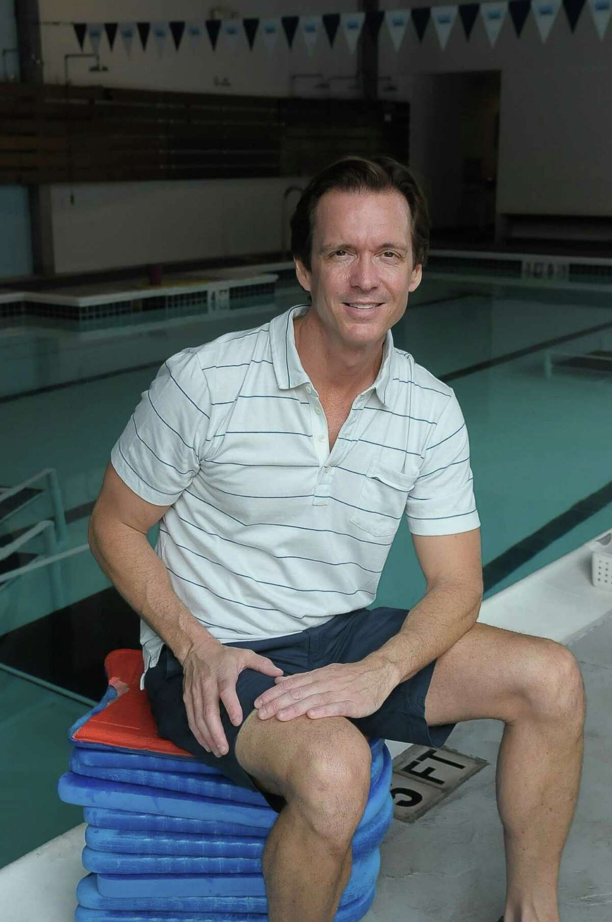 Chad Neal is celebrating the Saint Street Swim's 20th year in business.