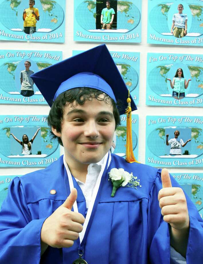 Lucas Ciccimarro offers a definitive 'thumbs up' moments after he and his Sherman School Class of 2014 peers had been presented their diplomas during the school's June 20, 2014 graduation exercises. Photo: Walter Kidd / The News-Times Freelance