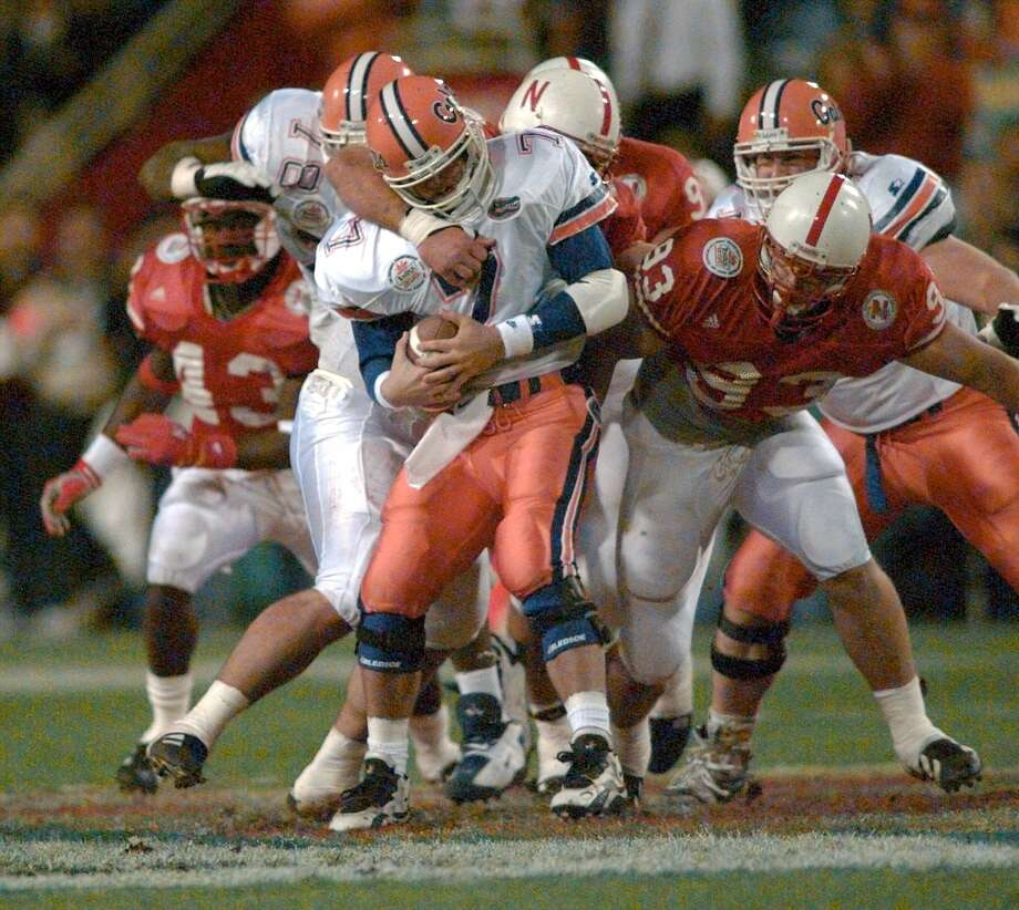 "1996 Fiesta BowlAnother clash of styles, the matchup between Steve Spurrier's pass-happy ""Fun 'n' Gun"" Florida Gators and Tom Osborne's run-oriented triple-option Nebraska Cornhuskers, wasn't much of a contest. Nebraska's defense smothered future Heisman winner Danny Wuerffel, while 'Huskers quarterback Tommie Fraser ran wild in a 62-24 Nebraska victory. Photo: BOB GALBRAITH, ASSOCIATED PRESS / AP1996"
