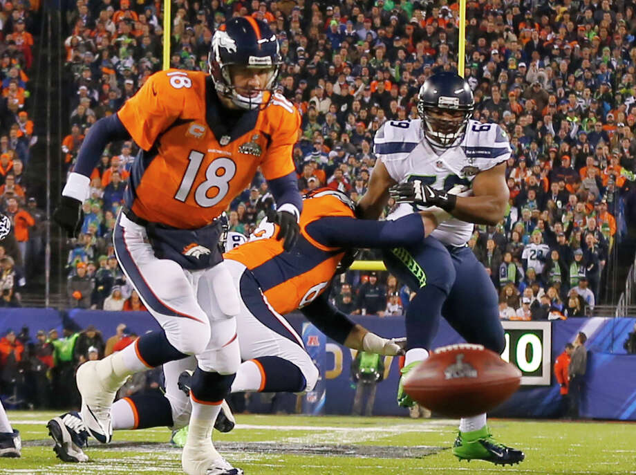 Super Bowl XLVIIIDefense versus offense, flash versus grit, brains versus brawn -- whatever the matchup between the Seattle Seahawks and Denver Broncos was supposed to be on Feb. 2, it wasn't close. The Seahawks scored a safety after a botched snap on the game's first play from scrimmage (above), then jumped out to a 22-0 halftime lead. When Percy Harvin returned the second-half kickoff for an 87-yard touchdown, it was all over but the crying in a 43-8 Seahawks victory. Photo: Paul Sancya, AP / AP2014