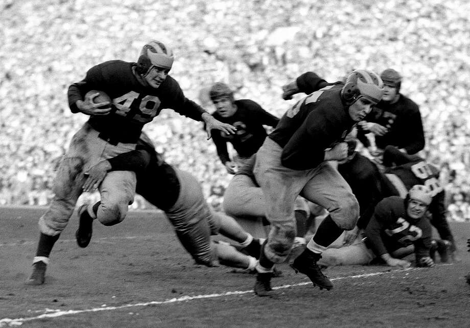 1948 Rose BowlThis classic matchup between two undefeated powers -- Big Nine champion Michigan and Pacific Coast Conference kings USC -- turned out to be ... less of a classic than anticipated. Halfback Bob Chappuis (49, left) ran for 91 yards and passed for 188 more as the Wolverines shut out the Trojans 49-0. Photo: Uncredited, AP / 1948 AP