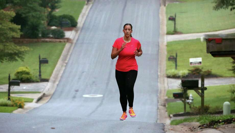 Bianca Cooper runs in Marietta, Ga., neighborhood, June 18, 2014. Cooper can run again, something she used to enjoy a lot in her Marietta subdivision before her stroke last year at age 29. Statistics show stroke is increasingly occurring among younger people. (Bob Andres/Atlanta Journal-Constitution/MCT) ORG XMIT: 1154394 Photo: Bob Andres / Atlanta Journal-Constitution