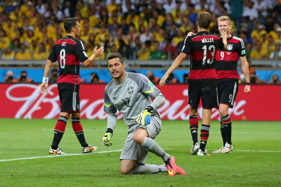 Brazil goalie Julio Cesar wears a dejected look after allowing Germany's sixth goal in a 7-1 defeat in a World Cup semifinal. Photo: Martin Rose, Getty Images