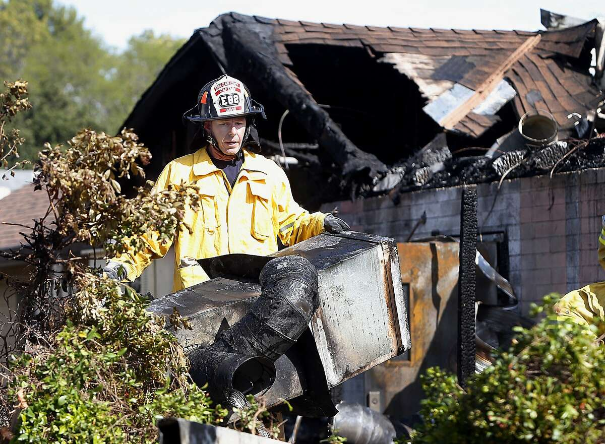Capt. Jeremy Davis begins investigating the cause of a fire at Manresa restaurant in Los Gatos, Calif., Monday, July 7, 2014. The top-rated Northern California restaurant was severely damaged and a firefighter is recovering from injuries after an early morning fire. (AP Photo/Bay Area News Group, Karl Mondon)