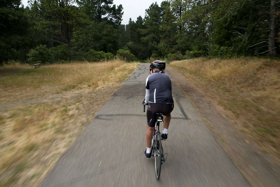Leo Le Bon, 80, takes a morning ride through Tilden Regional Park. Le Bon helped found one of the first U.S. firms to offer commercial mountain treks abroad. Photo: Tim Hussin, Special To The Chronicle
