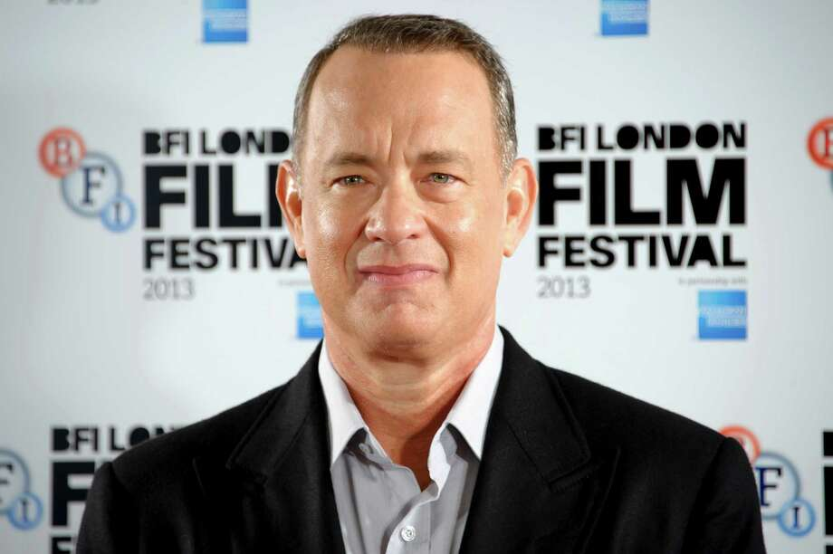 "FILE - This Oct. 9, 2013 file photo shows U.S actor Tom Hanks at the ""Captain Phillips"" photocall for the BFI London Film Festival in central London. Hanks was nominated for a Golden Globe for best actor in a motion picture drama for his role in the film on Thursday, Dec. 12, 2013.  The 71st annual Golden Globes will air on Sunday, Jan. 12. (Photo by Jonathan Short/Invision/AP, File) ORG XMIT: NYET741 Photo: Jonathan Short / Invision"