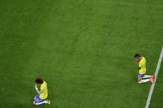 BELO HORIZONTE, BRAZIL - JULY 08: David Luiz (L) and Luiz Gustavo of Brazil react after being defeated by Germany 7-1 during the 2014 FIFA World Cup Brazil Semi Final match between Brazil and Germany at Estadio Mineirao on July 8, 2014 in Belo Horizonte, Brazil. Photo: Pool, Getty Images / 2014 Getty Images