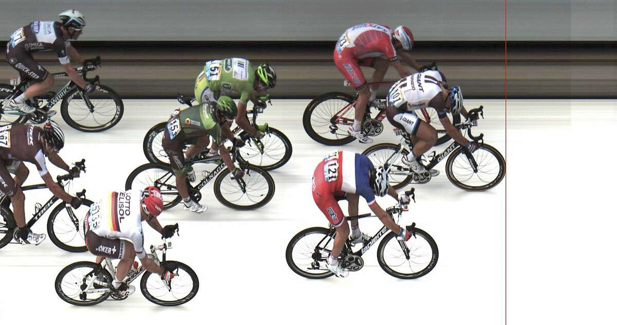 In this photo finish image released by ASO Marcel Kittel of Germany, front, crosses the finish line ahead of second place Norway's Alexander Kristoff, top, and third place France's Arnaud Demare, bottom, to win the fourth stage of the Tour de France cycling race over 163.5 kilometers (101.6 miles) with start in Le Touquet and finish in Lille, France, Tuesday, July 8, 2014. (AP Photo/ASO, HO)