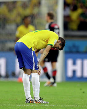Brazil's Oscar stands on the field after Germany's Andre Schuerrle scored his side's seventh goal during the World Cup semifinal soccer match between Brazil and Germany at the Mineirao Stadium in Belo Horizonte, Brazil, Tuesday, July 8, 2014. (AP Photo/Andre Penner) Photo: Andre Penner, Associated Press / AP