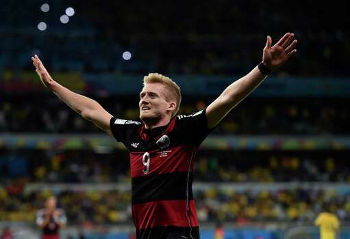 Germany's Andre Schuerrle celebrates after scoring his side's seventh goal during the World Cup semifinal soccer match between Brazil and Germany at the Mineirao Stadium in Belo Horizonte, Brazil, Tuesday, July 8, 2014. (AP Photo/Martin Meissner) Photo: Martin Meissner, Associated Press / AP