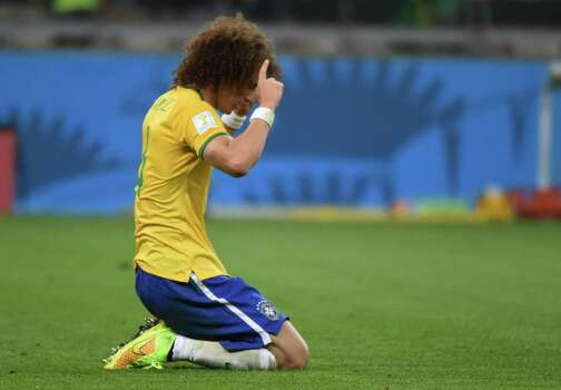 Brazil's defender David Luiz reacts after defeat in the semi-final football match between Brazil and Germany at The Mineirao Stadium in Belo Horizonte on July 8, 2014, during the 2014 FIFA World Cup . AFP PHOTO / CHRISTOPHE SIMONCHRISTOPHE SIMON/AFP/Getty Images Photo: CHRISTOPHE SIMON, AFP/Getty Images / AFP
