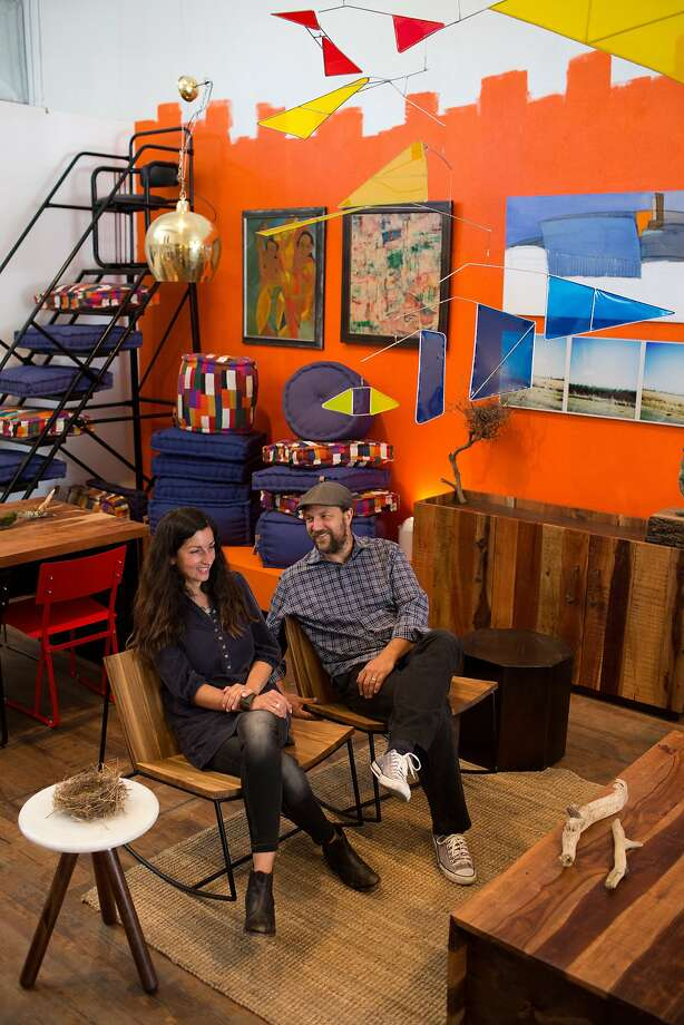 Sobu founders Alessandro and Laleh Latini in their Reclaimed Teak Rockers. Above, the Reclaimed Crate Coffee Table. Left: The Hinge table nearly doubles when the drop leaves are raised. Photo: Tim Hussin, Special To The Chronicle