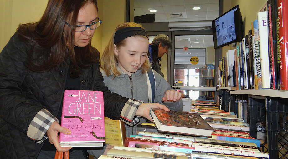 The Westport Library hosts its BOOKstravaganza. The Annual Gigantic Summer Book Sale runs Saturday through Tuesday. Find out more.  Photo: Mike Lauterborn / Westport News