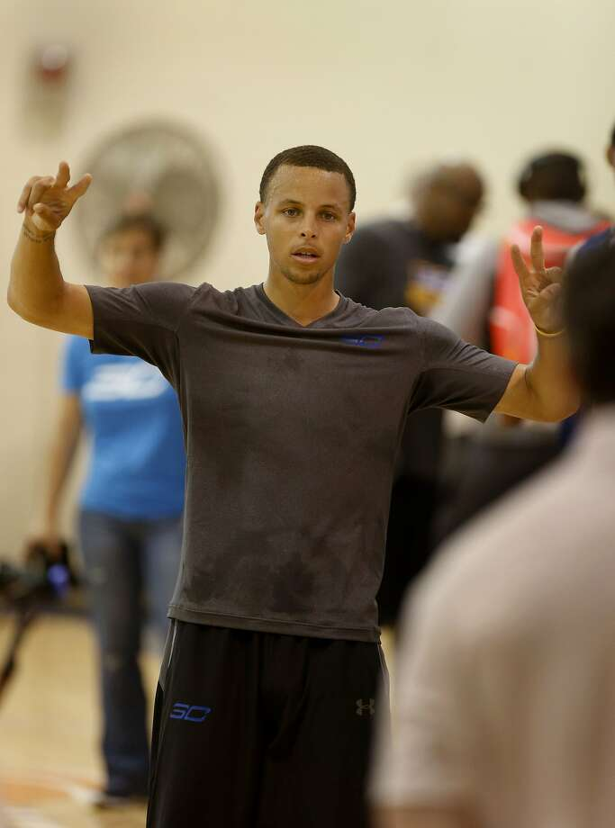 Stephen Curry walked the sidelines at his camp Monday June 30, 2014 in Alameda, Calif. Golden State Warriors guard Stephen Curry held his SC30 Select Camp for up and coming prep shooting guards at Saint Joseph Notre Dame High School in Alameda, Calif. Photo: Brant Ward, San Francisco Chronicle
