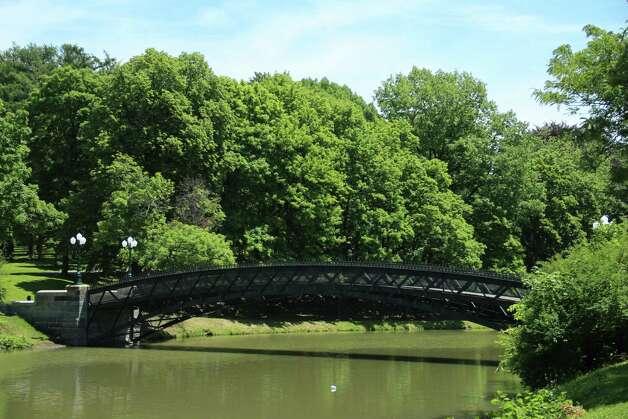 A serene summer scene is the bridge over the lake at Albany's Washington Park. (Rafael Gonzalez)
