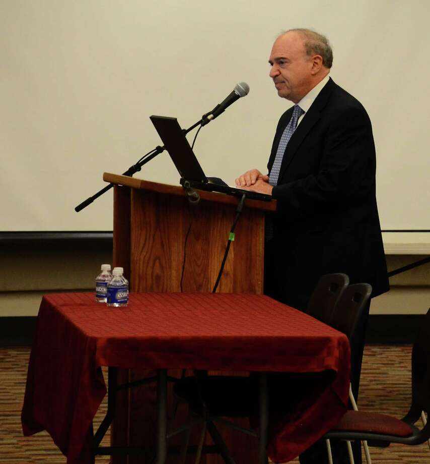 Putnam Road resident Michael Dorfsman addresses the Board of Education at a meeting Monday, July 7, 2014, at New Canaan High School, New Canaan, Conn. Photo: Nelson Oliveira / New Canaan News