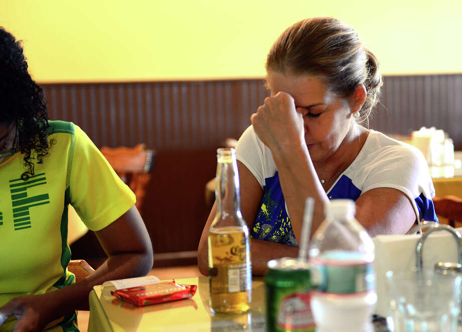 Claudia Santos sits dejected as Brazil loses to Germany in World Cup Soccer while watching the match on TV at Terra Brazil in Bridgeport, Conn. on Tuesday July 8, 2014. Photo: Christian Abraham / Connecticut Post