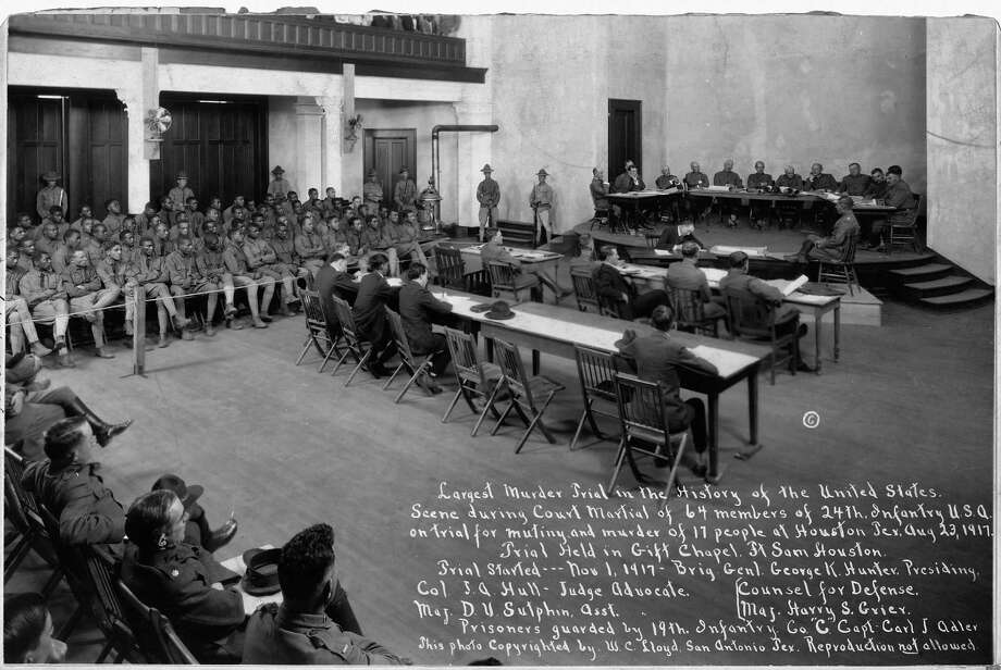 The full caption for this item is as follows: Largest Murder Trial in the History of the United States. Scene during Court Martial of 64 members of the 24th Infantry United States of America on trial for mutiny and murder of 17 people at Houston, Texas August 23, 1917. Trial held in Gift Chapel Fort Sam Houston. The Houston Riot of 1917, or Camp Logan Riot, was a mutiny by 156 African American soldiers of the Third Battalion of the all-black Twenty-fourth United States Infantry. It occupied most of one night, and resulted in the deaths of four soldiers and sixteen civilians. The rioting soldiers were tried at three courts-martial. A total of nineteen would be executed, and forty-one were given life sentences. Photo: Buyenlarge, Getty Images / Archive Photos
