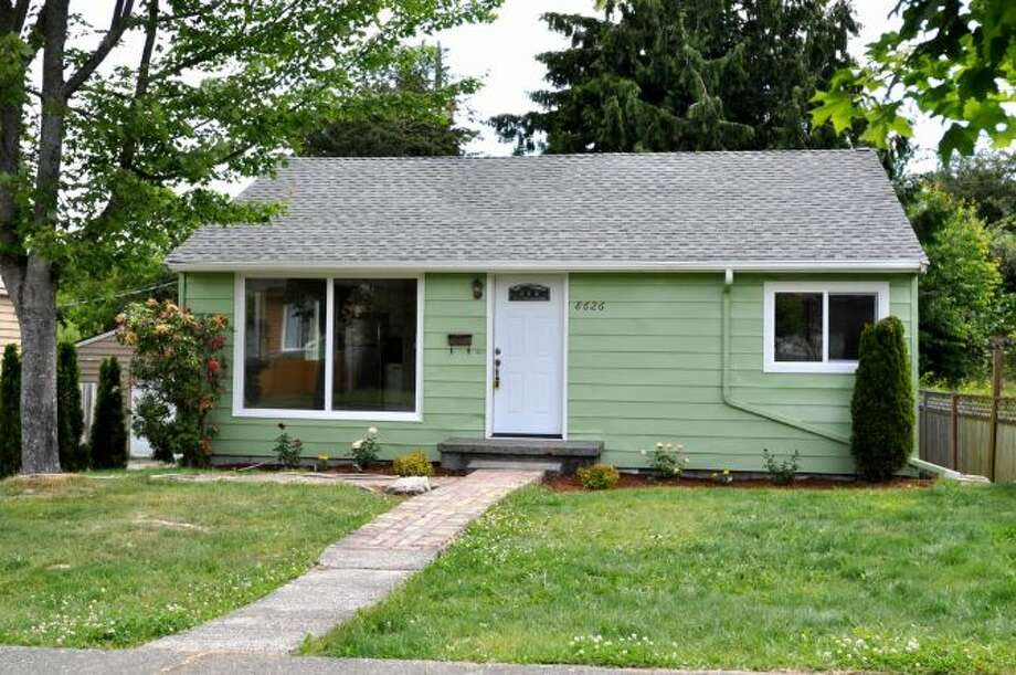 We'll start with the mid-priced home in our virtual tour, 8626 18th Ave. S.W., which is listed for $359,888. The 1,440-square-foot house, built in 1947, has four bedrooms, full and three-quarter bathrooms, many updates and a detached garage/shop on a 6,155-square-foot lot. Photo: Courtesy Christopher Nelson/Windermere Real Estate